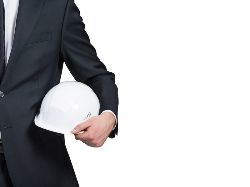 businessman engineer with helmet  on white background