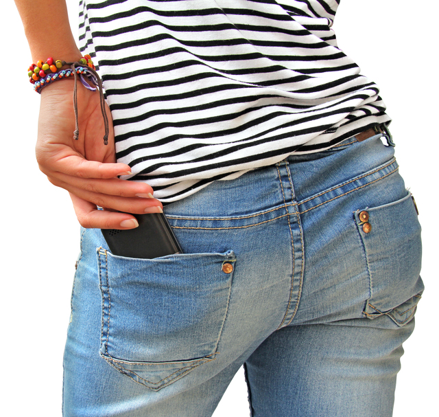 Cell smartphone in back pocket of girl's jeans