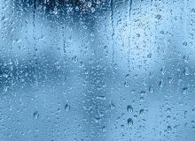 Raindrops on the window, abstract background. Blue tone
