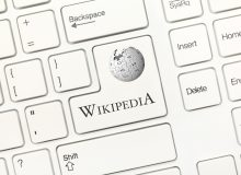 Close-up view on white conceptual keyboard - Wikipedia (key with logotype)