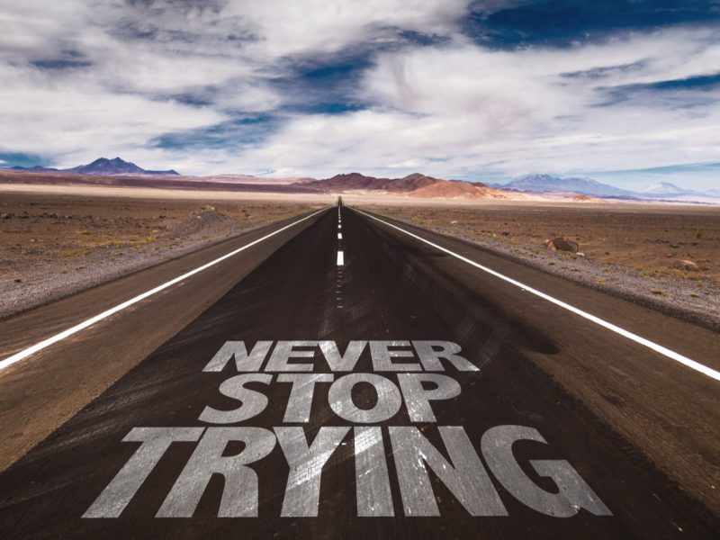 Never Stop Trying written on desert road