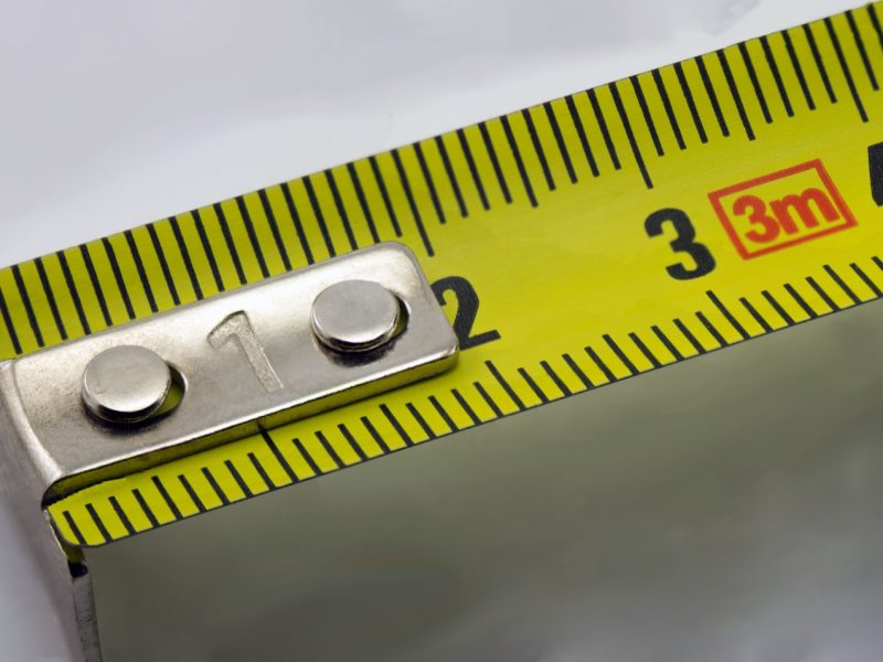 Measuring tape measure close-up on a white background