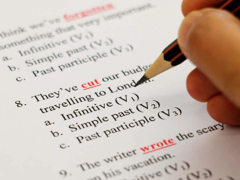 closeup english exam sheet on table with pencil