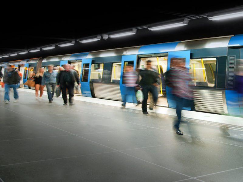 Blurred people on subway platform leaving the train