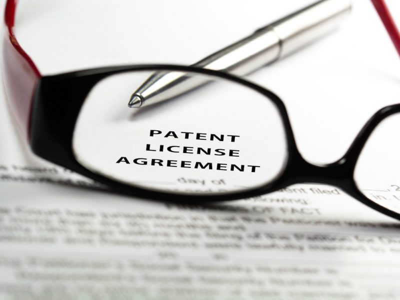 Patent license agreement through reading glasses.