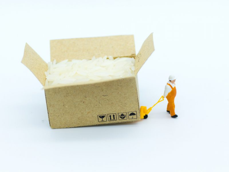 Miniature people: Farmers who sell rice trading business. Image use for business concept.