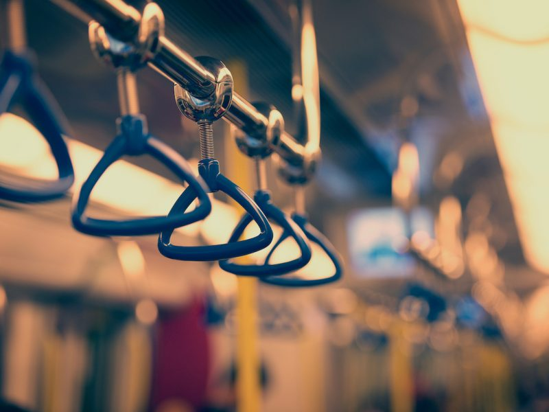 Metropolis. Handrails in a subway car in the photo instagram style.