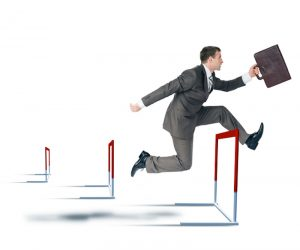 Businessman hoppig over barrier isolated on white background, competition concept