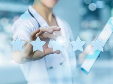 Health worker puts the rating stars on blurred background.