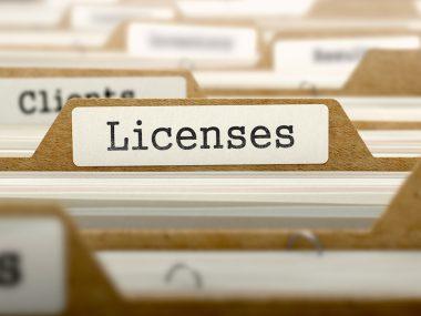 Licenses Concept. Word on Folder Register of Card Index. Selective Focus.