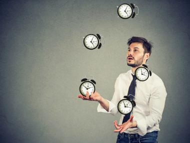 business man successfully juggling managing his time