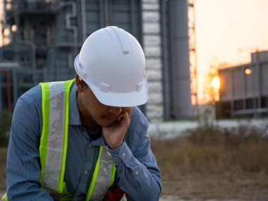 Workers Asian man sitting stressed. at power plant. Energy power station area. concept of Major depressive disorder, unemployed, sadness, depressed and human problems