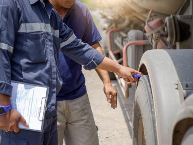 Truck drivers inspect order products in clipboard,Driver writing  in clipboard,Preforming a pre-trip inspection on a truck,preventive maintenance,check your truck,spot focus.