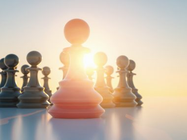 Leadership concept, red pawn of chess, standing out from the crowd of blacks pawn