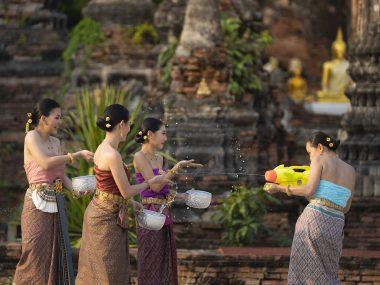 Songkran festival in Thailand. Happy Thai girls in Thailand cult