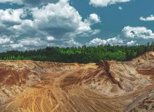 Color toned panorama of sand quarry and forest
